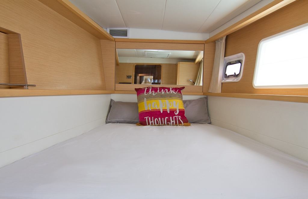 Aft cabin can be converted to twin share by means of a wooden divider on the queen bed so that it can accommodate two single guests if required | Elysia Charters
