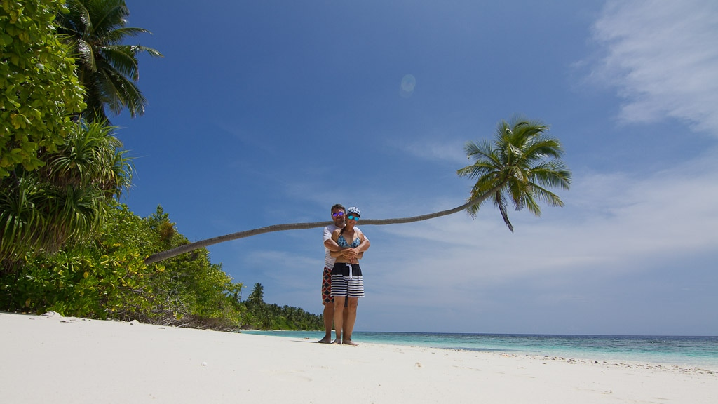 Couple standing on white sand Maldivian beach | Couples Charters | Elysia Charters