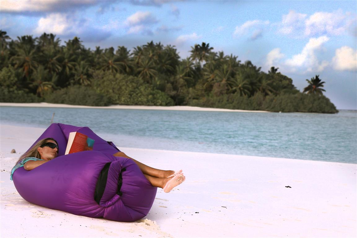 Reading a book on a tropical island in the Maldives | Elysia Charters