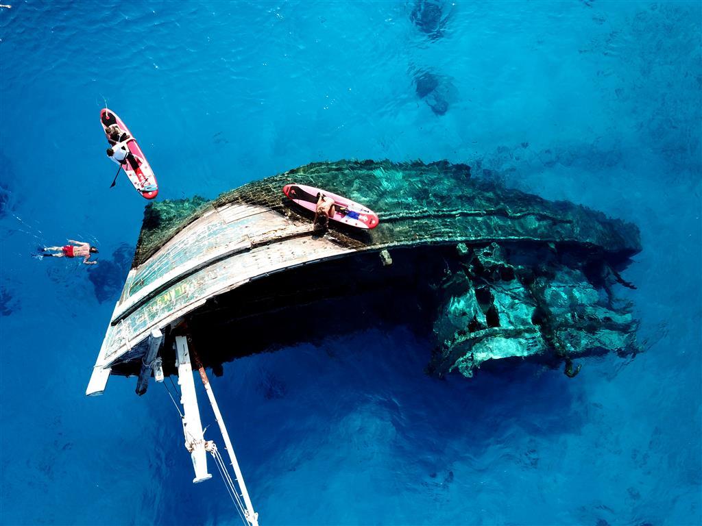 Snorkelling & Paddleboard a shipwreck | Exploring the Maldives | Elysia Maldives Catamaran Charter