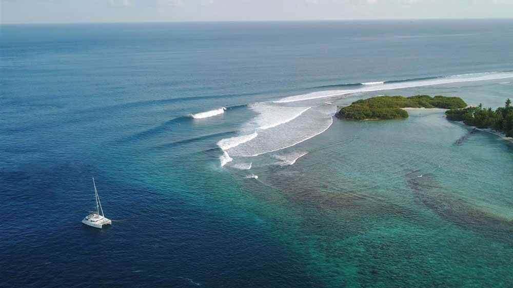 Cokes Maldives | Yacht anchored near surf break | Elysia Charters Maldives